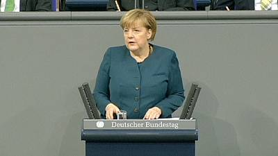 Tough-talking Merkel urges EU treaty change in first speech of new term
