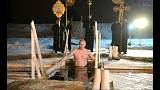 Putin takes traditional Epiphany dip in icy lake
