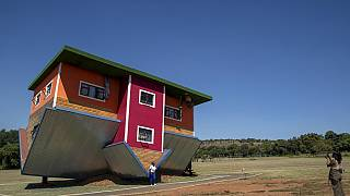 Roof down, floor up: South Africa's 'uʍop ǝpᴉsd∩' house attracts visitors