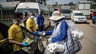 S. Africa: volunteers hand out soaps to curtail spread of COVID-19