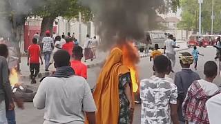 Somalians protest over fatal police shooting to enforce lockdown