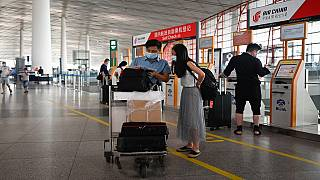 Beijing cancels flights over new virus as second wave lingers