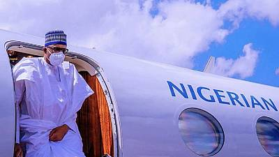 Photos: Nigeria president finally wears face mask