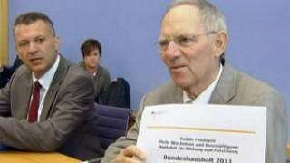 German cabinet approves more cuts