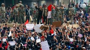 Suez marches on in defiance of protest ban
