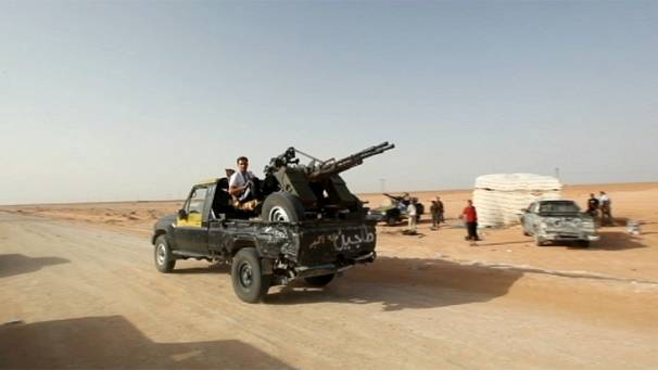 Libyan rebels capture airport connecting loyalist strongholds