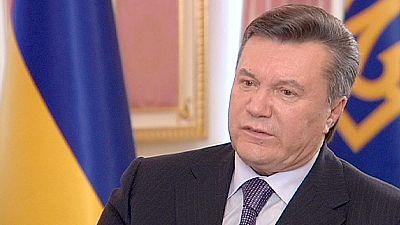 Ukraine's president defends Tymoshenko trial