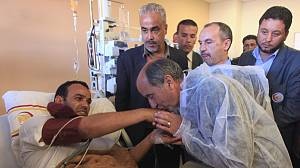 NTC leader visits wounded fighters in Benghazi