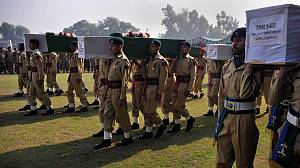Pakistan holds funerals for troops after NATO raid