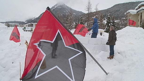 Big freeze fails to deter protesters at Davos
