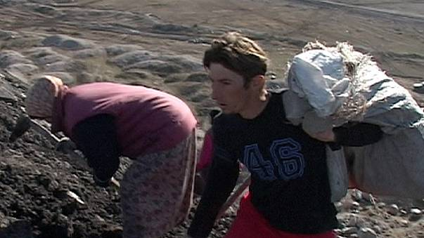 Carrying their future in Bosnia in bags of coal