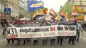 Thousands join anti-capitalism rallies