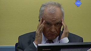 Mladic makes defiant gestures at war crimes trial