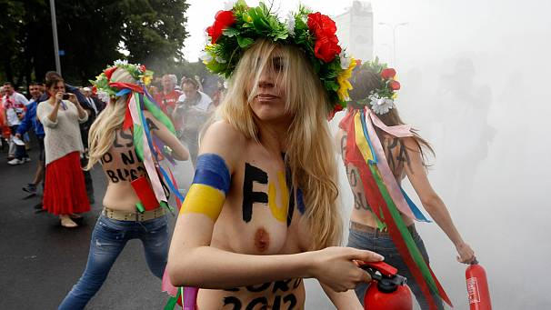 FEMEN activists strip in Euro 2012 protest