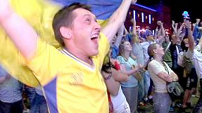 Ukraine supporters celebrate a shock win over Sweden