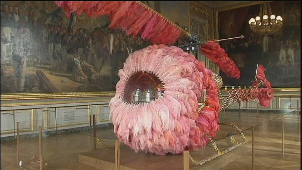 Pink helicopter and giant stilettos at Palace of Versailles