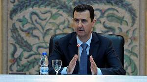 Assad talks of war as fighting reaches Damascus