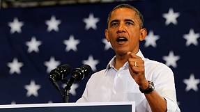 Obama steps up attacks on Romney