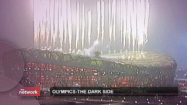 Обратная сторона Олимпийских медалей