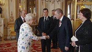 Queen Elizabeth hosts IOC members at Buckingham Palace