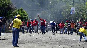 Rival presidential supporters clash in Venezuela