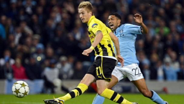 Man City salvage draw with Dortmund