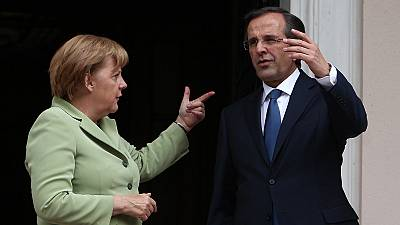 Atene accoglie Merkel a denti stretti