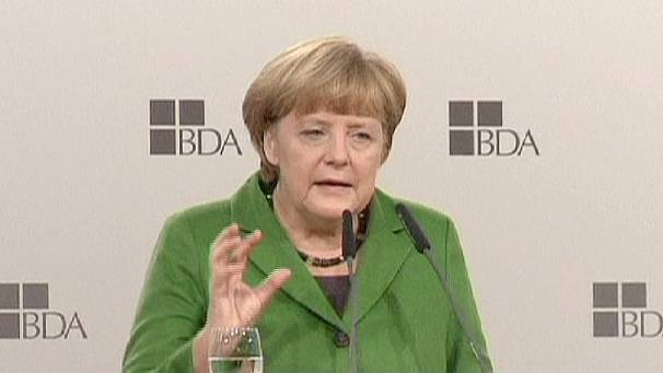 Merkel softens stance on eurozone strugglers