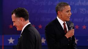 Obama, Romney trade barbs over taxes, economy
