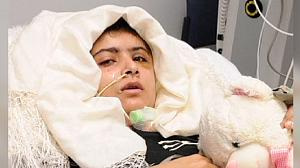 Shot Pakistani teenager stands for first time