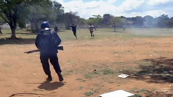 Clashes between riot police and South African miners