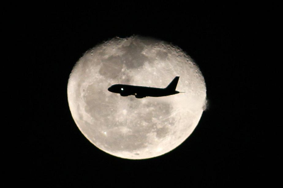 Flying in front of the moon
