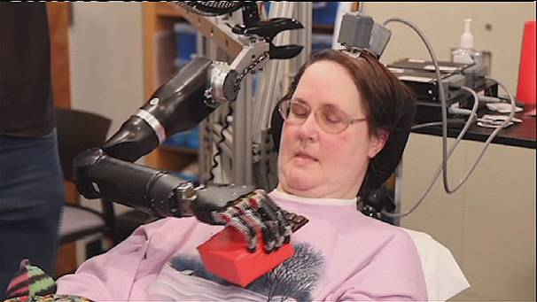 Paralysed woman feeds herself with robotic arm