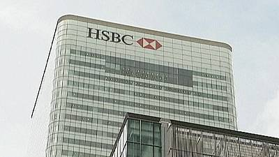 HSBC to lift dividend though 2012 profits dip