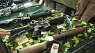 Setback for Obama as assault weapons ban is dropped