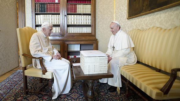 Pope meets former pope in historic encounter