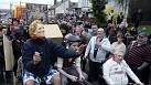 Anti-Thatcherites turn their back on Iron Lady's coffin