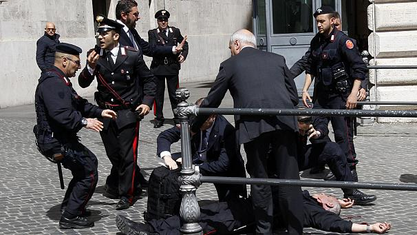 Italy's new prime minister visits police officer shot outside his office
