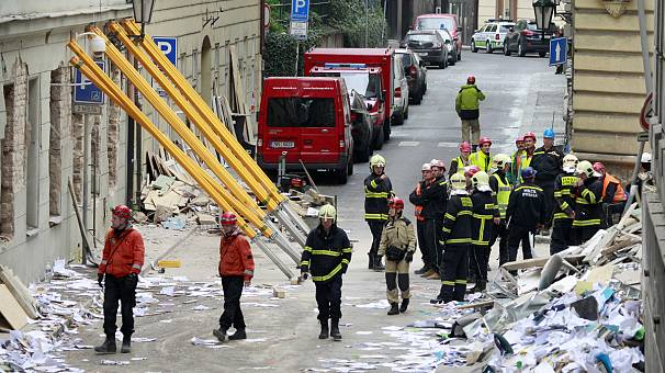 Rescuers search for workers buried in Prague office explosion