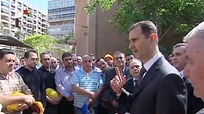 Defiant Assad visits Damascus power plant