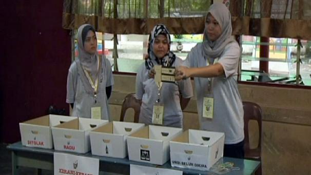 Polls close in tightly fought Malaysian election