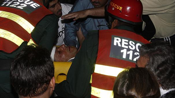Pakistan's Imran Khan injured by fall at rally
