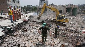 Woman pulled from rubble in Bangladesh factory disaster