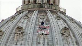 Anti-euro protester atop St. Peter's in Rome