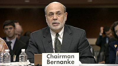 Bernanke says Fed stimulus continues for now