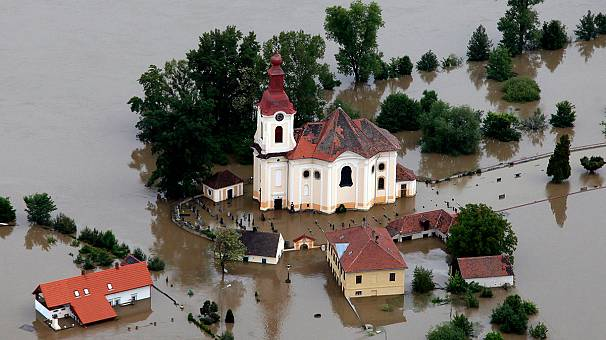 Prague residents assess flood damage as water recedes