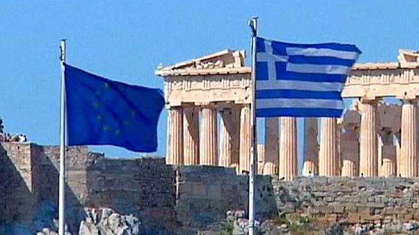 Greek economy shrinks further, EU hits back at IMF over bailout