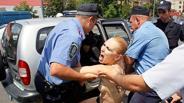 Topless Femen protesters target Angela Merkel's Office