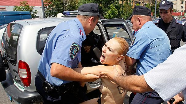 Topless Femen protesters target Angela Merkel's Office