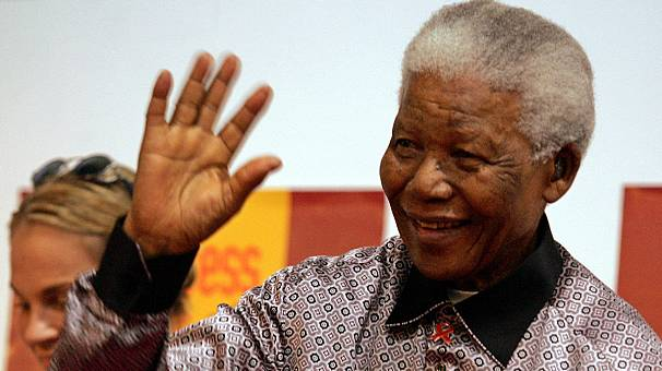 Mandela 'breathing on his own' in hospital